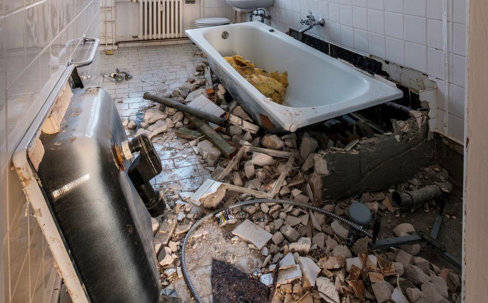 Bathroom demolition, bathtub and sink removal.